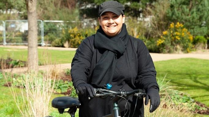 Portrait of Sabeha Miah with a bicycle